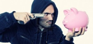 14445661-bad-guy-with-gun-and-piggy-bank-1024x494